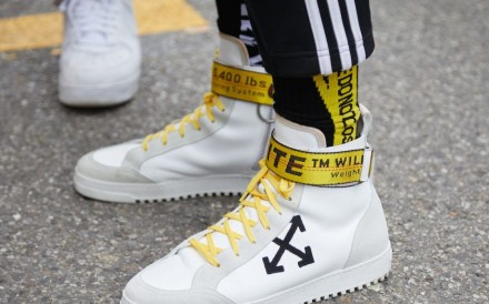 Luxury brands are increasingly collaborating with streetwear makers to create products that appeal to young, fashion-savvy consumers. Photo: andersphoto/Shutterstock.com