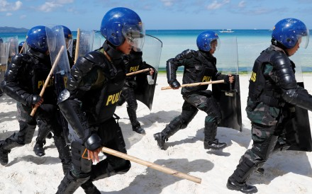 Anti-riot police take part in a simulation of a protest during a military and police drill in preparation for the temporary closure of the holiday island Boracay in Philippines. Photo: Reuters