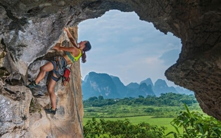 A female climber ascending the Egg, a well-known crag in Yangshuo, Guangxi province, China. Photo: Alamy