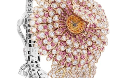Van Cleef & Arpels' Chrysanthème Secret watch is made of diamonds, pink sapphires, and spessartite garnets.