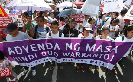 Protesters display placards in front of the Philippine Supreme Court. Photo: AP