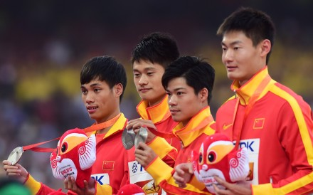 Xie Zhenye (second left) and Su Bingtian (second right) with their teammates after winning silver in the 4x100m at the 2015 IAAF World Championships. Photo: Xinhua