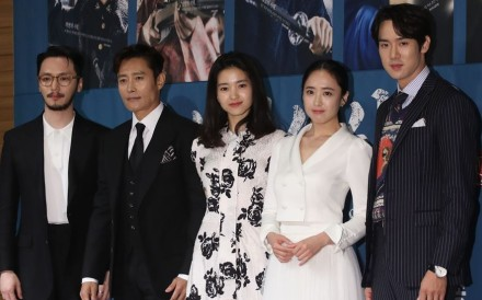 South Korean stars Lee Byung-hun (second left) and Kim Tae-ri (centre) with other cast members of 'Mr. Sunshine' at Tuesday's press conference in Seoul to promote the new Netflix television series. Photo: Yonhap