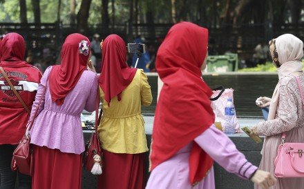 Women domestic helpers gather in Victoria Park in Causeway Bay on a Sunday. Photo: Nora Tam