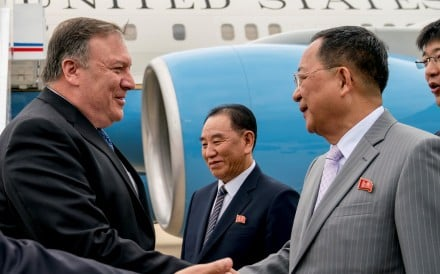 US Secretary of State Mike Pompeo being greeted by North Korean Director of the United Front Department Kim Yong-chol. Photo: Reuters