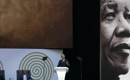Former US President Barack Obama delivers the 16th Annual Nelson Mandela Lecture, at the Wanderers Stadium in Johannesburg, South Africa, on July 17. In his highest-profile speech since leaving office, Obama urged people around the world to respect human rights and other values under threat, in an address marking the 100th anniversary of anti-apartheid leader Mandela's birth. Photo: AP