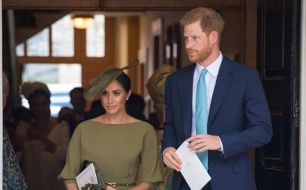 Prince Harry, Duke of Sussex and Meghan, Duchess of Sussex, wearing an olive-green Ralph Lauren dress at the christening of Britain's Prince Louis. Picture: AFP