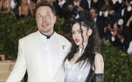 Elon Musk (left) co-founder and CEO of the electric vehicle maker Tesla – pictured with artist Grimes – says he is looking for video game developers to create games that will integrate his cars and touch screens with phones. Photo: Reuters