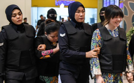 Indonesian defendant Siti Aishah and Vietnamese defendant Doan Thi Huong. Photo: AFP