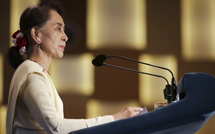 Myanmar's unofficial leader Aung San Suu Kyi speaking in Singapore. Photo: AP