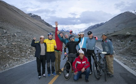 China's Zhou Zhuangchen (white hat) with his support team after 'Everesting Everest' – cycling over 423km and 8,848 metres up and down the road that leads to Everest, the height of the world's largest mountain. Photo: Matthias Magg