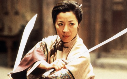Michelle Yeoh, who plays a stylish and uptight society matron in Crazy Rich Asians, starred as a warrior in Ang Lee's 2000 film, Crouching Tiger Hidden Dragon. Photo: Alamy