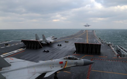 Chinese J-15 fighter jets on the deck of the Liaoning aircraft carrier during a military drill in the Yellow Sea in 2016.. Photo: AFP