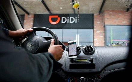 A new driver in his vehicle for Chinese ride-hailing firm Didi Chuxing, in Toluca, Mexico. Photo: Reuters