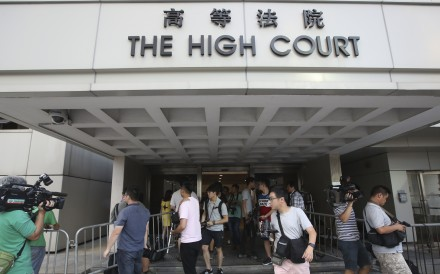 Reporters keep watch at the entrance to Hong Kong's High Court in Admiralty. Photo: Edward Wong