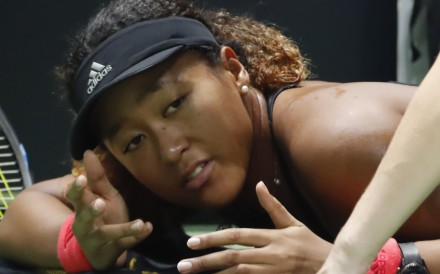 Naomi Osaka receives treatment on the court during a medical timeout against Kiki Bertens at the WTA Finals in Singapore. Photo: AP