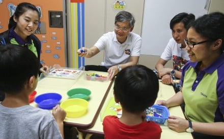 Law Chi-kwong, Hong Kong's Labour and Welfare secretary, visits a childcare centre in Tin Shui Wai in July 2017. Photo: David Wong