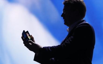 Justin Denison, Samsung Electronics senior vice-president of Mobile Product Marketing, unfolds Samsung's new foldable screen smartphone, during the Samsung Developers Conference in San Francisco on Wednesday. Photo: Reuters