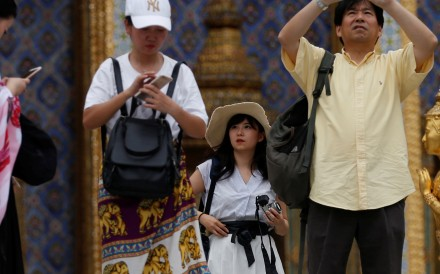 Chinese tourists at Wat Phra Kaew in Bangkok, Thailand. Picture: Reuters