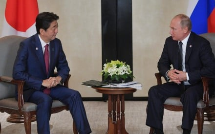 Russian President Vladimir Putin meets with Japanese Prime Minister Shinzo Abe during their meeting on the sidelines of the 33rd Association of Southeast Asian Nations Summit. Photo: EPA