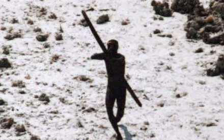 A Sentinelese tribesman takes aim with his bow at an Indian Coast Guard helicopter as it flies over North Sentinel Island in 2004. Members of one of the world's last tribes untouched by modern civilisation have killed an American who ventured illegally onto their remote island, Indian police have said. Photo: AFP / Indian Coast Guard / Survival International