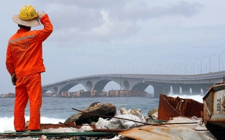 A construction worker looks at the China-funded Sinamale bridge in Male, Maldives. Photo: Reuters