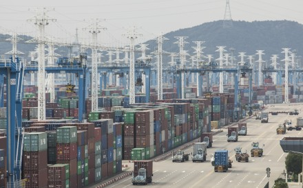 Containers stacked next to gantry cranes at the Port of Ningbo-Zhoushan in Ningbo in eastern China on Wednesday, October 31, 2018. Photo: Bloomberg