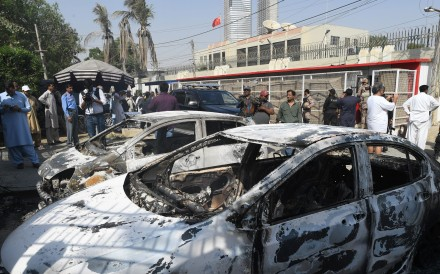 Burned out vehicles outside the Chinese consulate in Karachi following last month's attack. Photo: AFP
