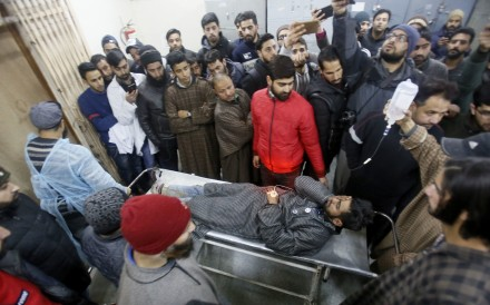 An injured Kashmiri civilian is brought on a stretcher to a hospital in Srinagar, Indian-controlled Kashmir. Photo: AP