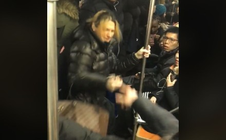 Mobile phone footage captured the attack on an unidentified Asian woman on the New York City subway on Tuesday. Image: Juan Ayala via Facebook