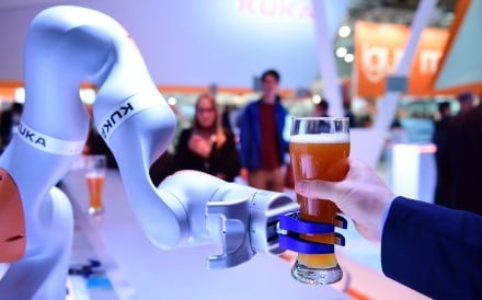 A Kuka robot serves beer at the Hanover Fair in Germany on April 24, 2017. The acquisition of the German industrial robotics manufacturer by appliance maker Midea in 2016 has led to concerns about investments by Chinese companies in Europe. Photo: AFP