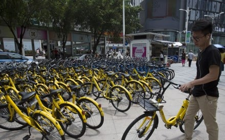 People use mobile payment to rent Ofo bikes, a bike sharing service in Shenzhen, China. Photo: SCMP