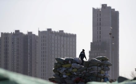 Apartment blocks under construction on the outskirts of Beijing. The outlook for China's property market has dimmed. Photo: Reuters
