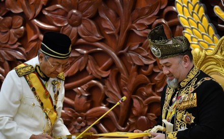 The shock abdication of Malaysia's Sultan Muhammad V – seen here with Prime Minister Mahathir Mohamad – has prompted speculation about his successor. Photo: AFP
