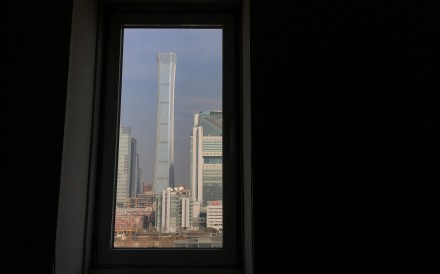 China Zun tower and other buildings are seen through a window in Beijing's central business area. Photo: Reuters