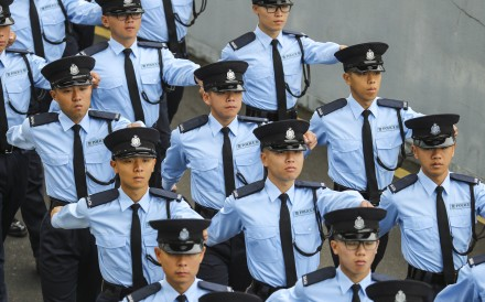 Hong Kong police officers march in a Force Remembrance Day parade, for colleagues killed while serving the community. The highest-ranked woman in the history of the city police will step down in March and become head of the Office of the Ombudsman in April. Photo: Winson Wong