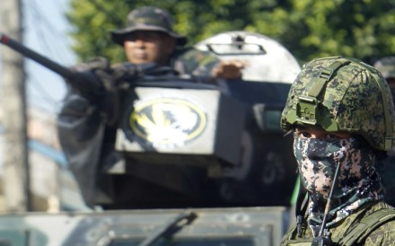 Philippine government troops conduct a patrol in Jolo town, on the volatile island of Sulu, southern Philippines. Photo: EPA