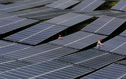 Workers check solar panels at a photovoltaic power station in Chongqing, China, in July 2018. The country installed 53GW of solar power in 2017. Photo: Reuters
