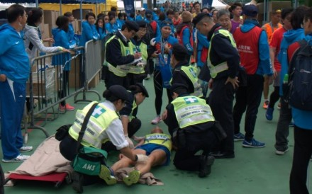 Paramedics attend to a runner who collapsed at the finish line of last year's Standard Chartered Hong Kong Marathon. Photo: Mark Agnew