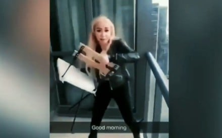 A woman identified as Marcella Zoia is seen in a Toronto police video as she prepares to hurl a chair from the 45th floor of a Toronto high-rise. Photo: Toronto Police
