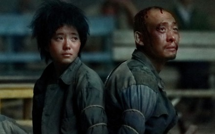 Zhang Yi and Fan Wei in a scene from One Second, directed by Zhang Yimou. The film was withdrawn from competition at the Berlin International Film Festival earlier this week.
