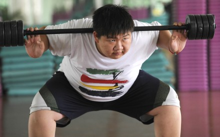 A man works out in Beijing. China's public health crisis could cost the country trillions of dollars. Photo: AFP