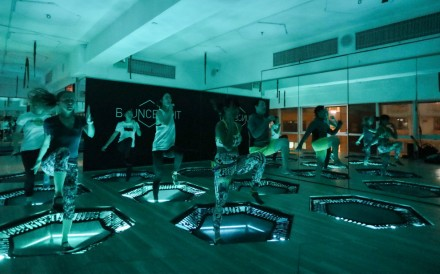 """Fitness fans can work out while having fun in the dark in this Hong Kong gym class, where the trampolines are equipped with flashing LED lights.Unlike running,the """"rebounding"""" fitness class is a..."""