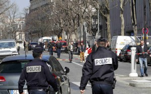Police outside the International Monetary Fund (IMF) offices where an envelope exploded in Paris. Photo: Reuters
