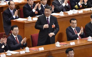 Xi Jinping (centre) sent a strong nationalist message in his closing speech to the National People's Congress on Tuesday. Photo: Kyodo