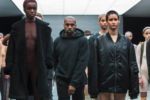Kanye West walks past models after presenting his Fall/Winter 2015 partnership line with Adidas at New York Fashion Week in 2015.
