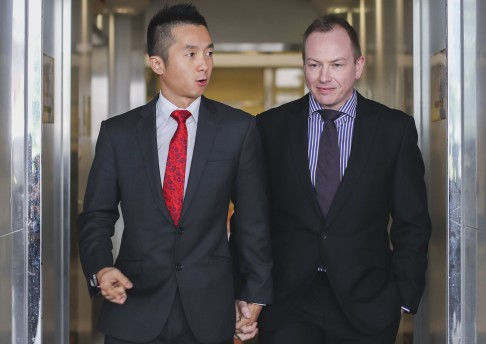 Civil servant Angus Leung (l) with his partner Scott Adams (r). Hong Kong courts recently overturned a ruling allowing him to claim spousal benefits, claiming that homosexual relationships posed a threat to traditional marriage.
