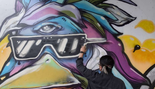 Graffiti booms in streets of Ho Chi Minh City as artists push back against censorship