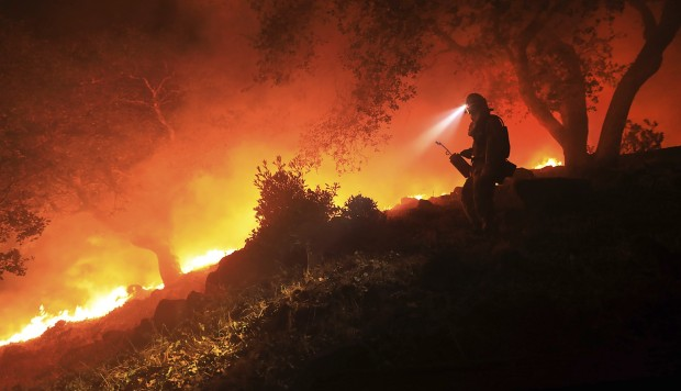 Residents under siege from rampaging California fires start search for the dead and missing, as toll hits 31