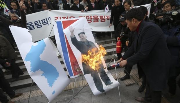 Pictures of Kim Jong-un burn as star North Korean singer tours Seoul